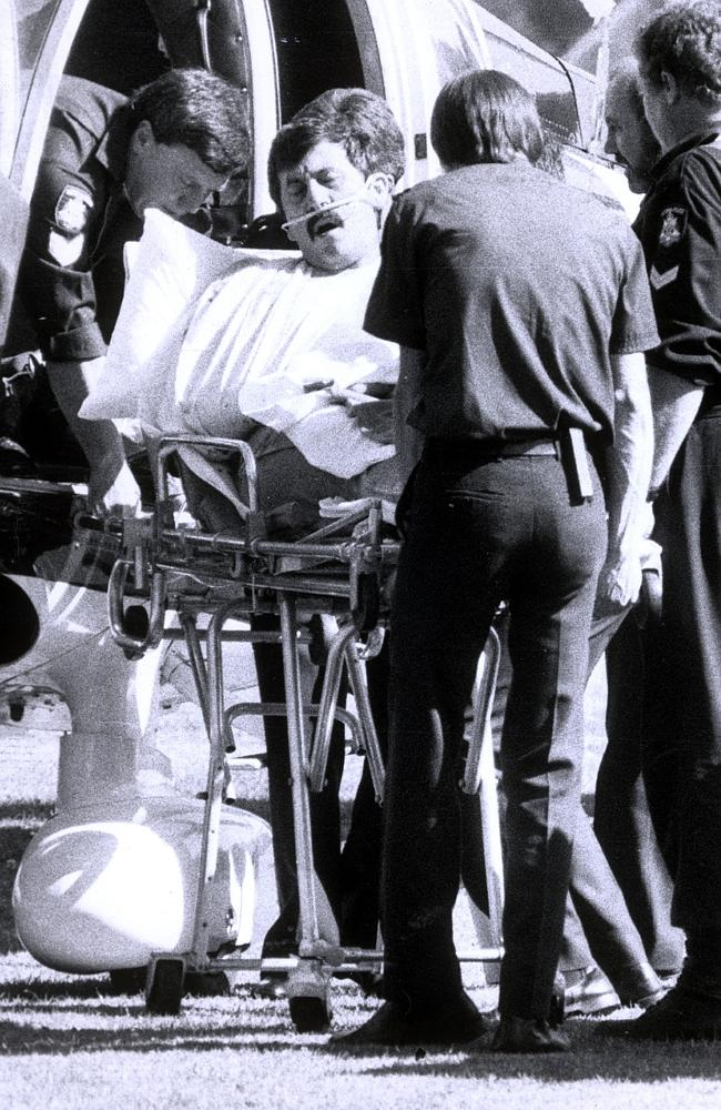 A wounded Kapetanovski, shot twice by Marinof, is loaded on to the air ambulance. Picture- Photo File