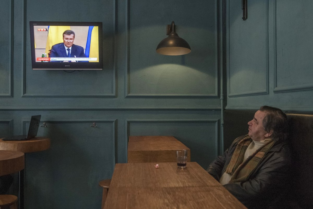 a-local-resident-of-kiev-ukraine-watches-a-news-broadcast-while-having-a-drink