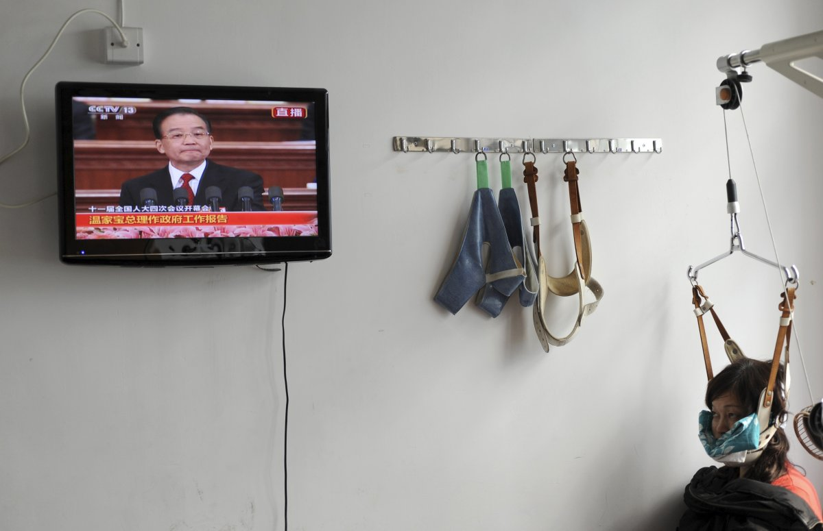 a-patient-watches-a-televised-government-broadcast-while-receiving-medical-treatment-at-a-chinese-hospital-in-jiaxing