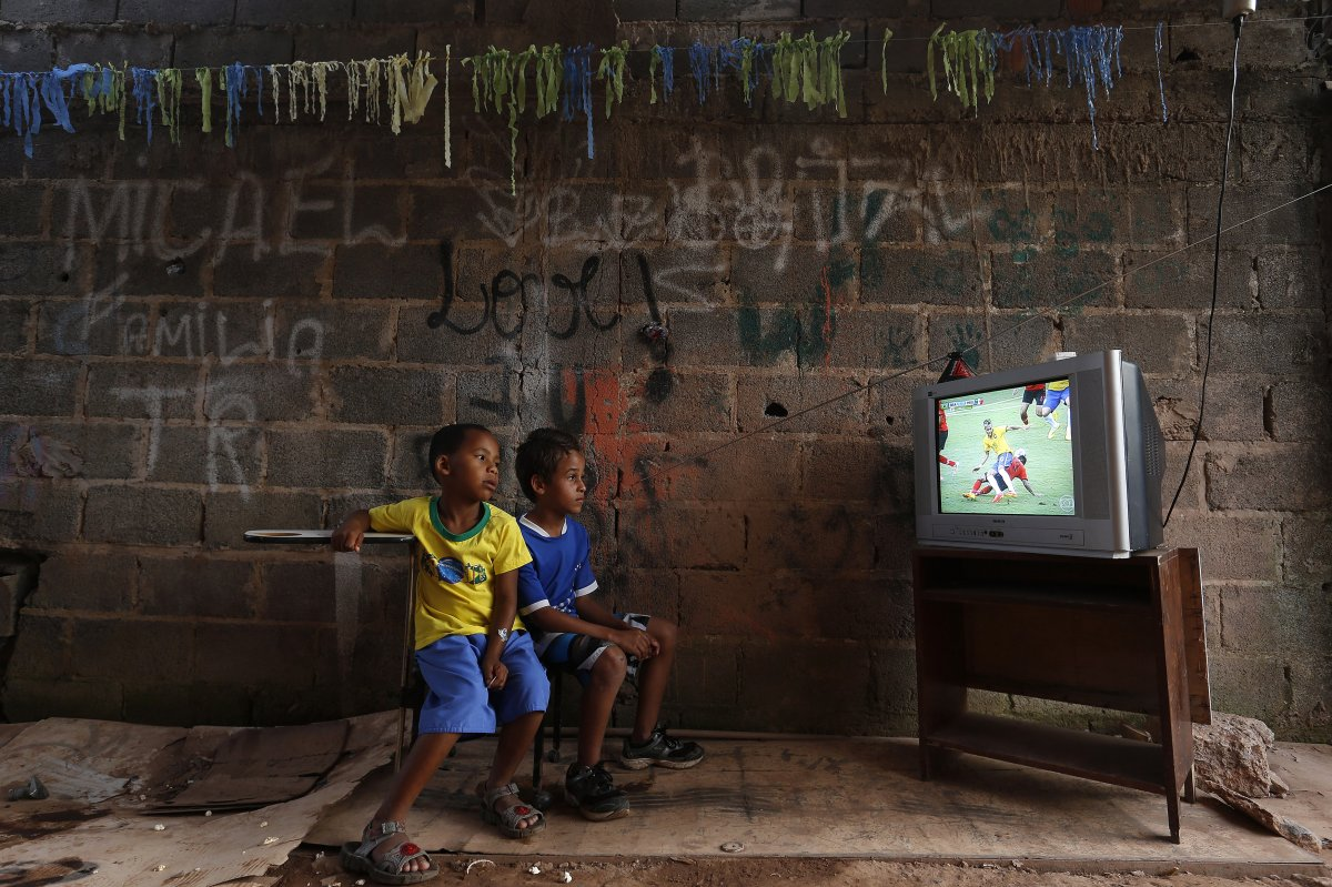 during-the-world-cup-a-couple-of-young-boys-on-the-outskirts-of-brasilia-watch-as-their-home-team-brazil-plays-against-mexico