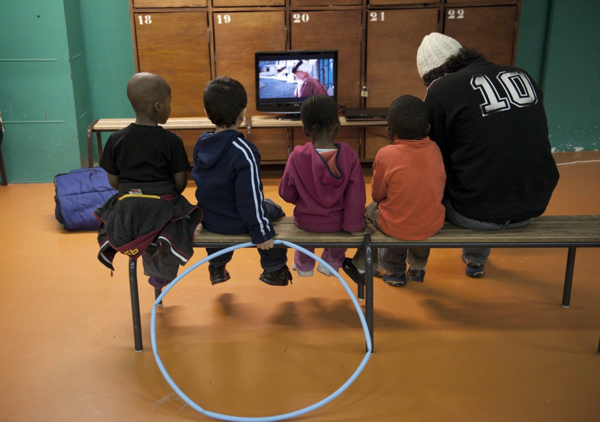 the-saint-merri-gym-in-paris-shows-tv-programming-as-children-sit-on-the-bench-and-watch