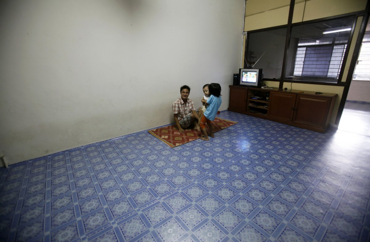 within-kuala-lumpur-the-capital-of-malaysia-a-myanmar-refugee-family-sits-in-the-lounge-of-their-empty-apartment