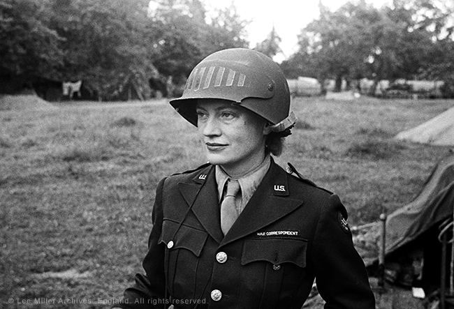 web-5848-28-Lee-Miller-in-steel-helmet-specially-designed-for-using-a-camera-Normandy-Unknown-Photographer-1944