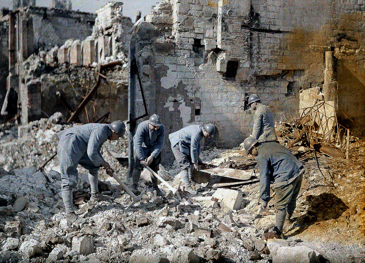 Five French soldiers are clearing the rubble in the ruins of Reims, which was destroyed almost 60 per cent by German artillery and air raids during World War I. 1917. Color photo (Autochrome Lumière) by Fernand Cuville (1887-1927). Western Front. Reims, France. (Photo by Galerie Bilderwelt/Getty Images)