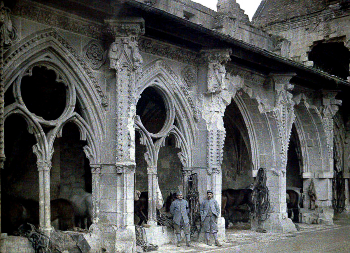 Two French soldiers and horses in the cloister of the abbey de Saint-Jean-des-Vignes, which was heavily damaged by artillery fire. 1917. Color photo (Autochrome LumiËre) by Fernand Cuville (1887-1927). World War I, Western Front. Soissons, Aisne, France. (Photo by Galerie Bilderwelt/Getty Images)