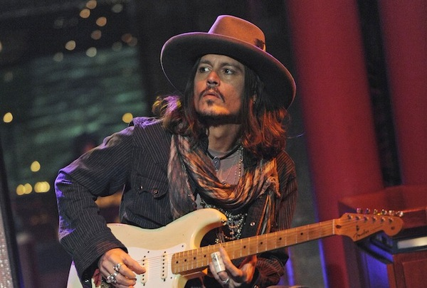 "In this photo provided by CBS, actor Johnny Depp plays slide guitar on the set of the ""Late Show with David Letterman."" Thursday Feb. 21, 2013 in New York. Depp accompanied musical guests ""Bill Carter and the Blame."" (AP Photo/CBS, Jeffrey R. Staab) MANDATORY CREDIT; NO SALES; NO ARCHIVE; FOR NORTH AMERICAN USE ONLY"